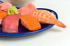 Asian Raw Fish Sushi Dinner w/ Shrimp Tuna Salmon. Asian Raw Fish Sushi Dinner w/ Shrimp, Tuna, Salmon, including rice, ginger, and wasabi Royalty Free Stock Image
