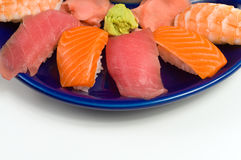 Asian Raw Fish Sushi Dinner w/ Shrimp Tuna Salmon. Asian Raw Fish Sushi Dinner w/ Shrimp, Tuna, Salmon, including rice, ginger, and wasabi Royalty Free Stock Photo