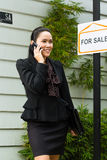 Asian Realtor presenting a new home Stock Photo