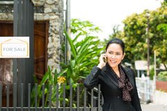 Asian Realtor presenting a new home Royalty Free Stock Image