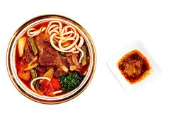 Asian Red Noodle Soup With Vegetable stock photos