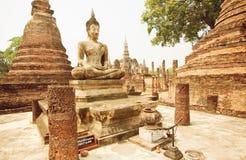 Asian religious art landmark - Brick temple Wat Maha That with Buddha statue Stock Photography