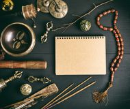 Asian religious musical instruments for meditation and notebook. Asian religious musical instruments for meditation and alternative medicine, blank notebook with royalty free stock photography