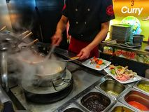 Asian food in a restaurant. Asian restaurant, chef cooking asian food stock images