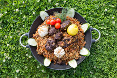 Asian rice dish with meat. Pilaf. In a big bowl Royalty Free Stock Photos