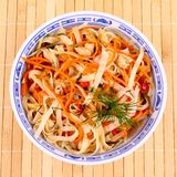 Asian rice noodle salad with chicken meat and carrots Royalty Free Stock Photo