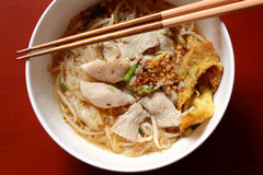 Asian rice noodle soup with pork, fish ball and crisps dumpling. Stock Photo