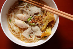 Asian rice noodle soup with pork, fish ball and crisps dumpling. Stock Photos