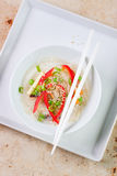 Asian rice noodles with vegetables and sesame in a bowl on a marble background Stock Image