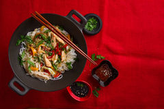 Asian rice noodles wok with chicken and vegetables Royalty Free Stock Photo