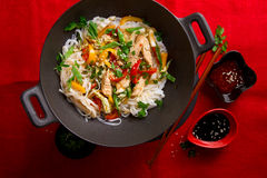 Asian rice noodles wok with chicken and vegetables Stock Image