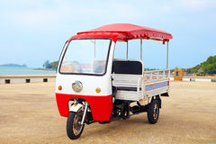 Asian rickshaw vehicle parked on the road Stock Image