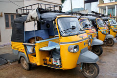 Asian rickshaws/tempos/ tuktuks in row royalty free stock photos