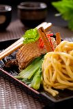 Peking duck noodle. Asian roasted duck noodle soup royalty free stock photography