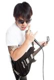 Asian rocker play guitar and sing with rock hand sign Stock Image