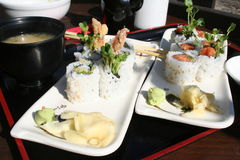 Asian Rolls. Tiger Shrimp and Spicy Tuna rolls served with Ginger and Wasabi Royalty Free Stock Photo