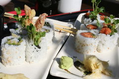 Asian Rolls. Close up of Tiger Shrimp and Spicy Tuna rolls served with Ginger and Wasabi Royalty Free Stock Photography