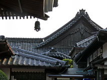 Asian roofs. Parts of roofs of japanese houses covered with black tiles stock photos