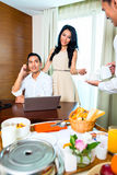 Asian room service waiter serving in hotel room Royalty Free Stock Image