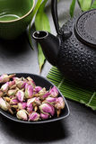 Asian rose tea and teapot Royalty Free Stock Image