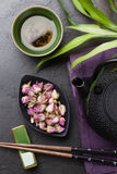 Asian rose tea and teapot Stock Images