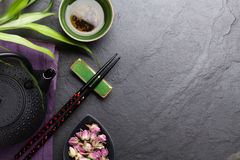 Asian rose tea and teapot Royalty Free Stock Photo