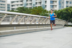 Asian runner on bridge road Royalty Free Stock Images