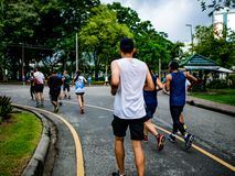 Asian runner Group Jogging in the city central park stock images