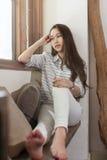 Asian sad woman sitting near window depressed royalty free stock images