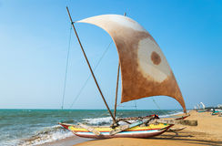 Asian sailboat on coasline Stock Images