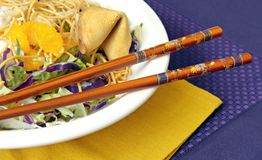 Asian Salad with Chopsticks Stock Image