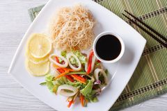 Asian salad with squid and rice noodles horizontal top view Royalty Free Stock Photo