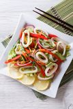 Asian Salad of squid with vegetables vertical top view Royalty Free Stock Images