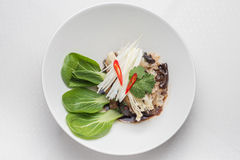 Asian salad, on white plate. Asian salad, pn white plate, wooden tabe Stock Photo