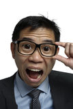 Asian Salary reacting in a shocked manner with big eyes Stock Photos