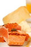 Asian salmon served with caviar and pumpkin soup Royalty Free Stock Photography