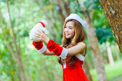 Asian Santa girl with bear Stock Image