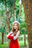 Asian Santa girl with bear Royalty Free Stock Images