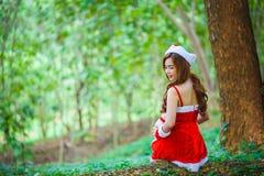 Asian Santa girl with bear Royalty Free Stock Image