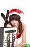 Asian santa girl with her gift. Royalty Free Stock Photo