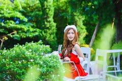 Asian Santa girl with puppy Royalty Free Stock Photos