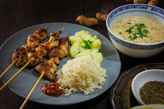 Asian satay meat skewers with rice, cucumber salad and peanut sa Stock Image