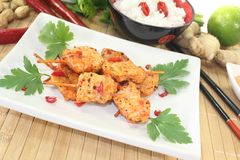 Asian satay skewers with chilli and parsley Stock Photos