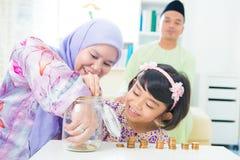Asian saving money Stock Images