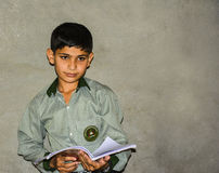 An Asian school boy holding a book Royalty Free Stock Photography