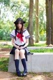 Asian school girl with charming eyes. Thai Asian school girl with charming eyes Stock Photos