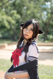 Asian school girl with charming eyes. Thai Asian school girl with charming eyes Royalty Free Stock Image