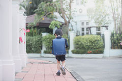 Asian school girl with pink backpack looking up Royalty Free Stock Image