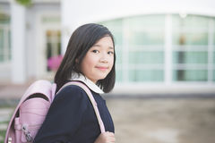 Asian school girl with pink backpack outdoors Royalty Free Stock Images
