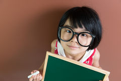 Asian school kid with chalk and chalkboard Stock Image